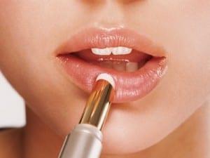 woman-applying-lip-balm